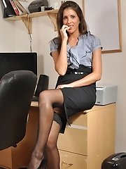 Kitty strips in the office to show her gorgeous young cunt