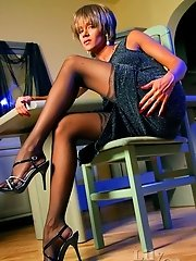 Charming leggy lady in vintage black stockings