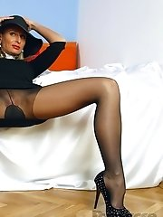 Horny busty MILF in sexy sheer black pantyhose and high heels