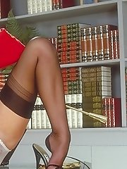 Dirty school teacher shows her long elegant legs in black stockings