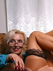 Sexy mature blonde shows luxury legs in vintage stockings